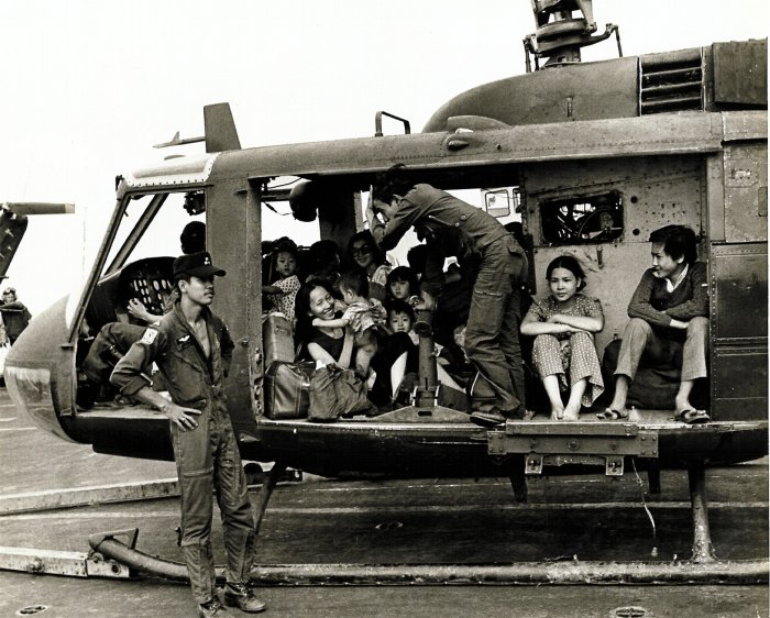 VNAF Huey full with evacuees.