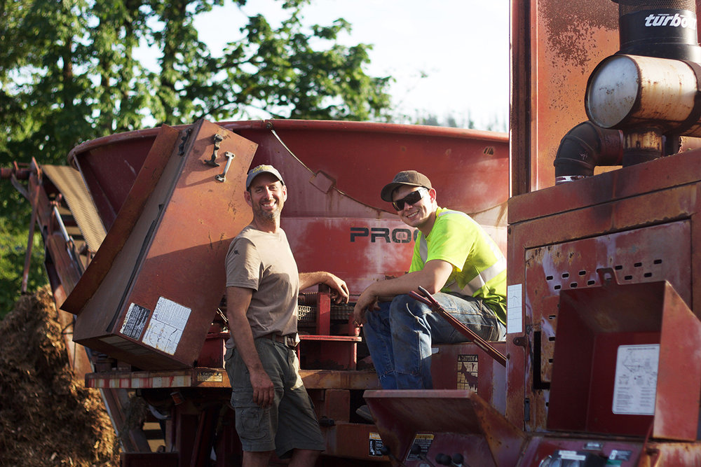 Paul & Dillon Sayers servicing the grinder that pocesses wood debris that is recycled at Pine Creek.
