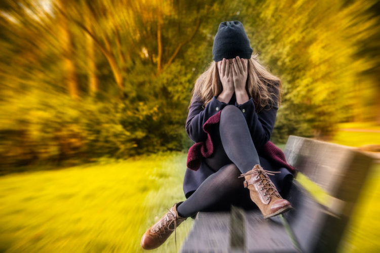 young girl crying park bench.jpg
