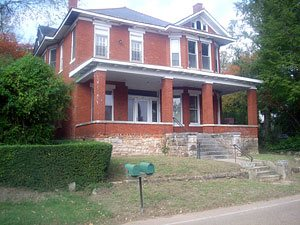 Here's a small, not-so-great photo of the house when we purchased it. Not our most horrific beginning, but definitely a house in need of a little love. The biggest change we made was returning this house to a single family home. When we purchased it, it was divided into an upstairs apartment and a downstairs apartment.