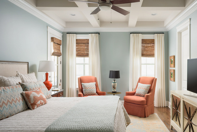 This room gets some beautiful natural light. We also love the coffered ceiling, hardwood floors, and tall doors. The chairs, bedding and pillows were brought over from the clients' previous home. Everything else was selected to work with these design elements.
