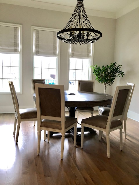Here's a sneak peek of a dining room project that's complete but not yet professionally photographed. Simple linen roman shades with neutral trim play a supporting role to a yet to be revealed superstar design element that is just out of camera range in this shot. Stay tuned to see more of this gorgeous home soon!