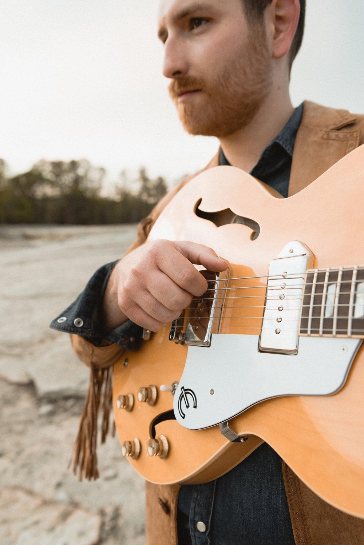 taylor kropp photo w guitar.jpg