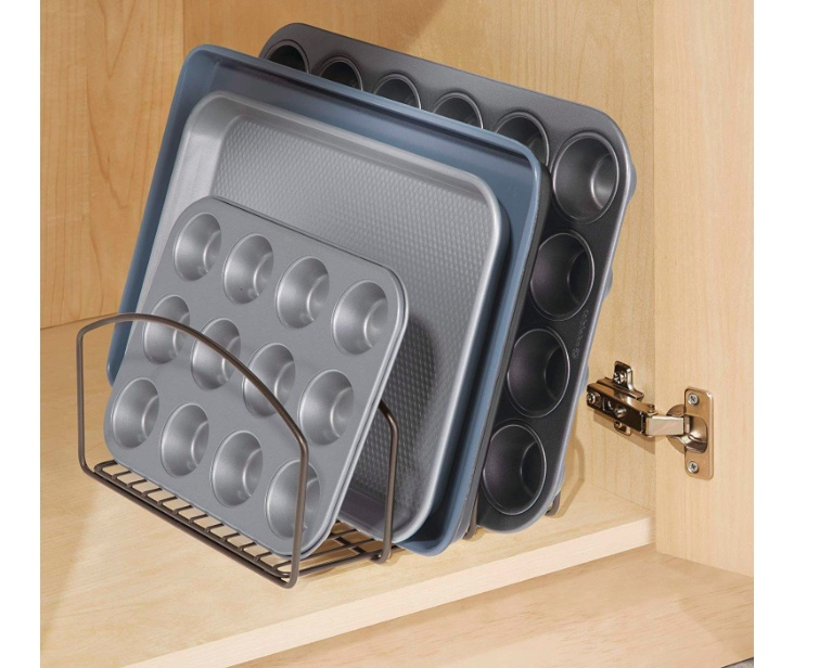 Vertical Pan Stacker - The obvious solution to finding what you need without pulling everything out of the cupboard. These racks are so useful. Look how easily you can see what you have and how accessible the pans are stacked vertically. You can also stack chopping boards in the same way. Check this stacker here.