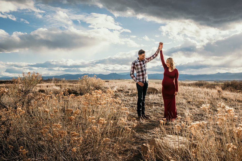 Miss. Miller's Photography | Colorado | Colorado photographer | Western Inspired Photographer | maternity photos | maternity photo shoot | red maternity dress | tight maternity dress | maternity poses | dirty boots and messy hair presets