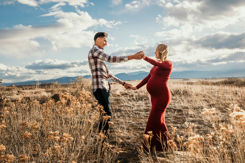 Miss. Miller's Photography | Candid maternity photos | maternity photo ideas | maternity photo shoot | Colorado Photographer | Colorado maternity photographer | Colorado mom | red maternity dress | candid posing | maternity poses | mom to be photos