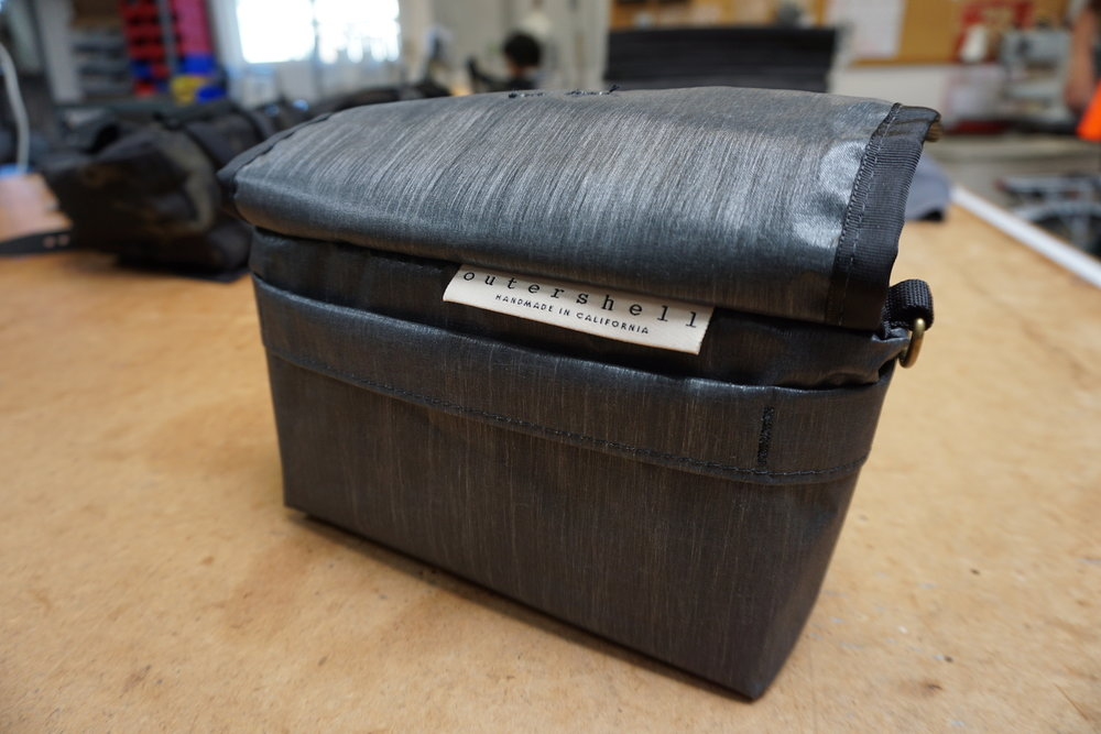 We purchased this one, the critically acclaimed Outer Shell Drawcord Handlebar Bag