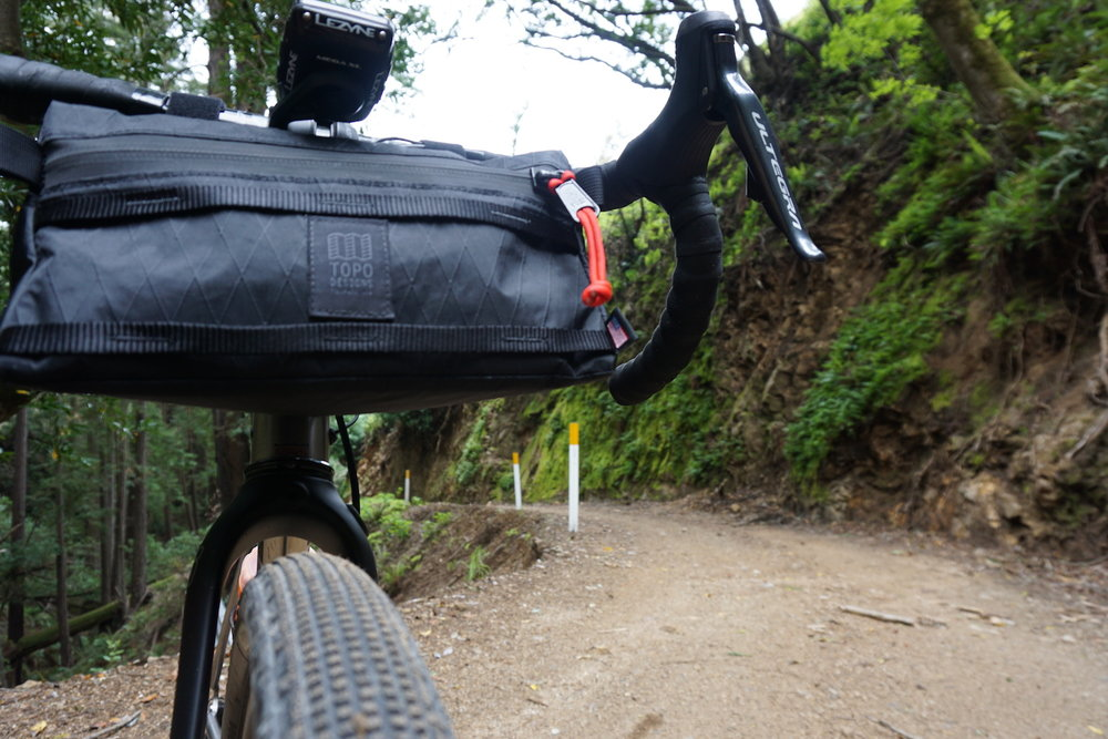 The Topo Designs Bike Bag features an oversized waterproof YKK zipper and paracord zipper pull