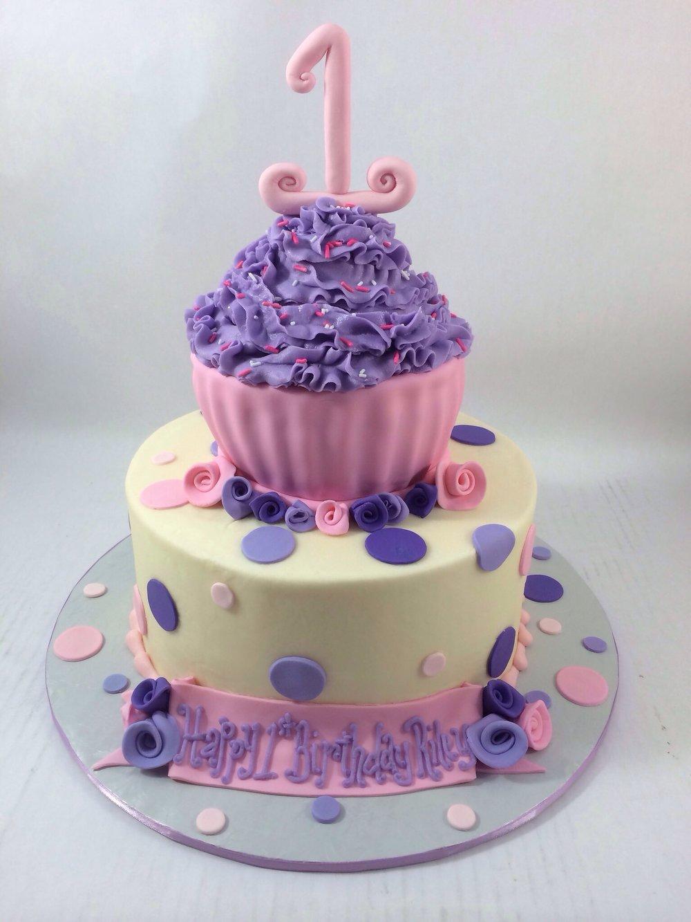 Cake 1st bday cupcake on top.JPG