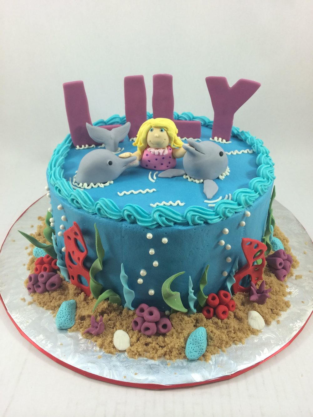 Cake girl with dolphins.JPG