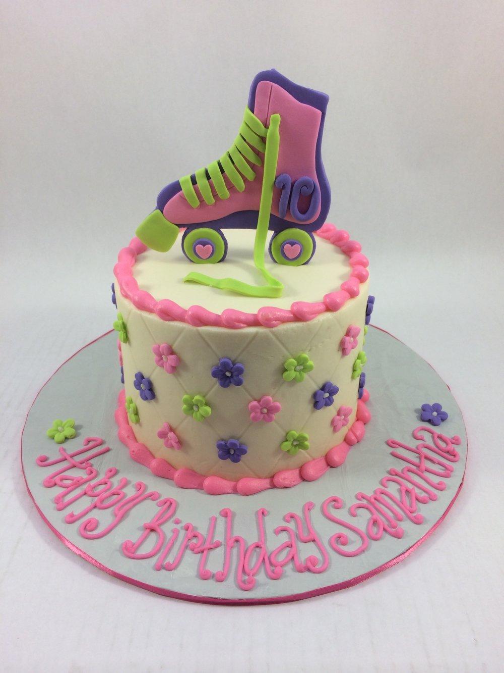 Cake roller skate on top.JPG