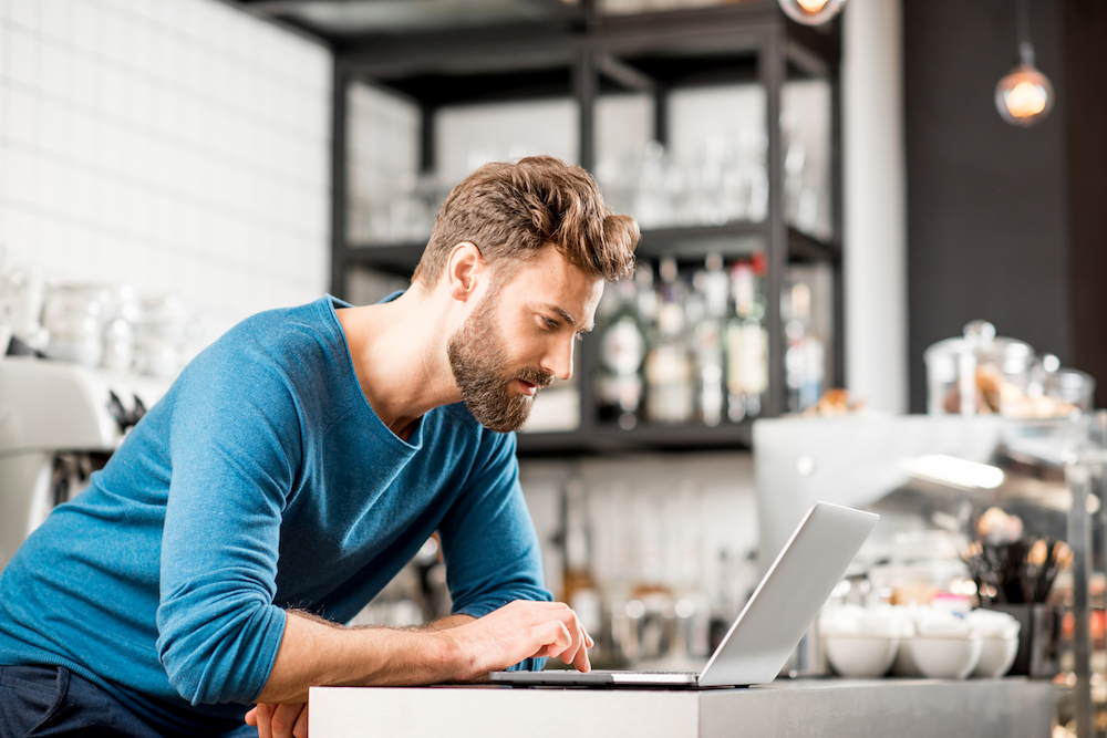 Man Freelance Consulting at Coffee Shop