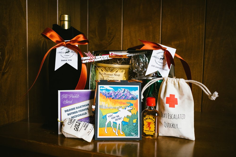 26 Our welcome box filled with DIY details, weekend event information, and snacks