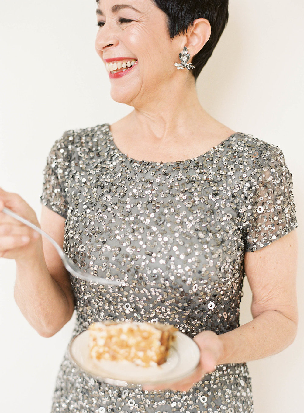 Mom eating cake in Adrianna Papell crunchy bead gown in lead silver sequin