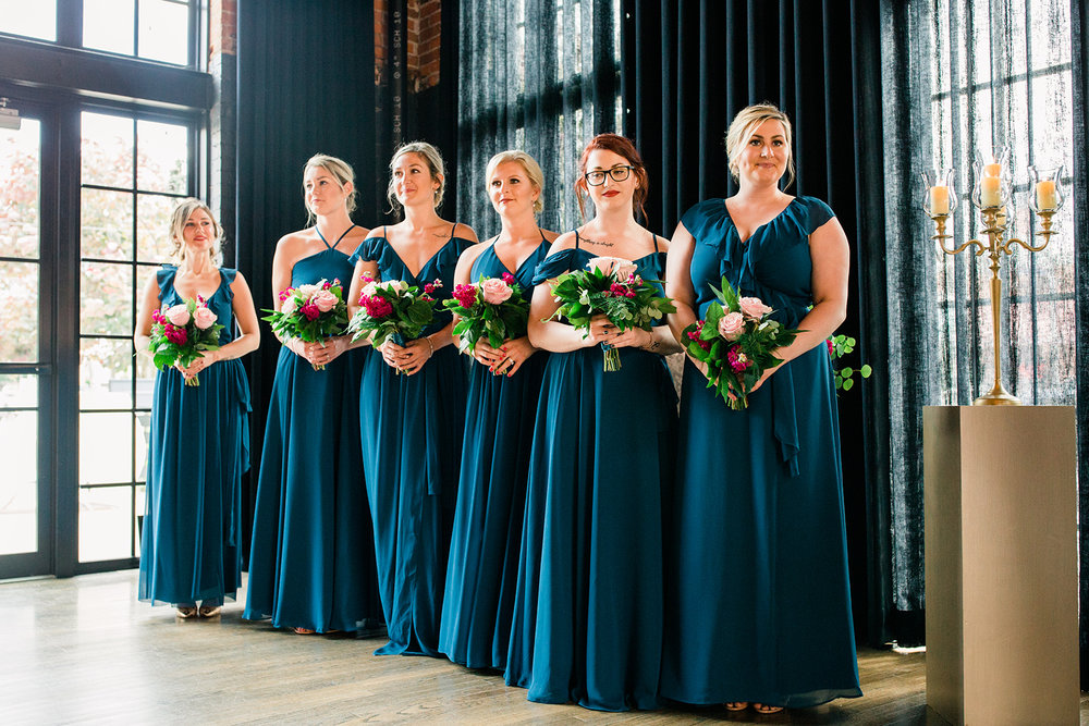 Joanna August bridesmaids standing at the ceremony in aqua chiffon dresses