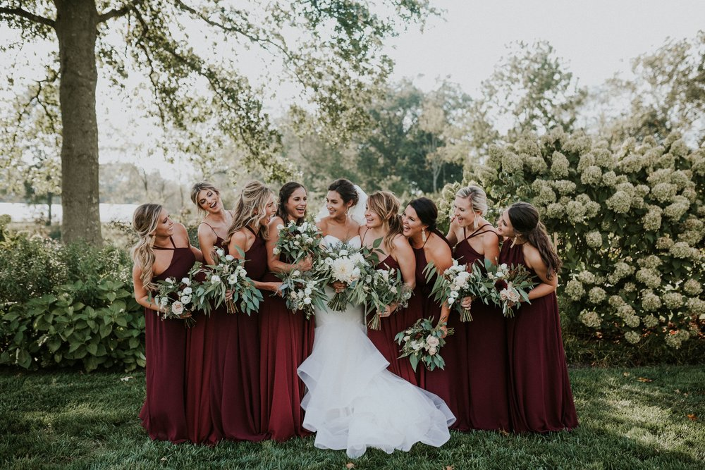 Mix and Match bridesmaids in hibiscus ruby red dresses by Jenny Yoo and Amsale