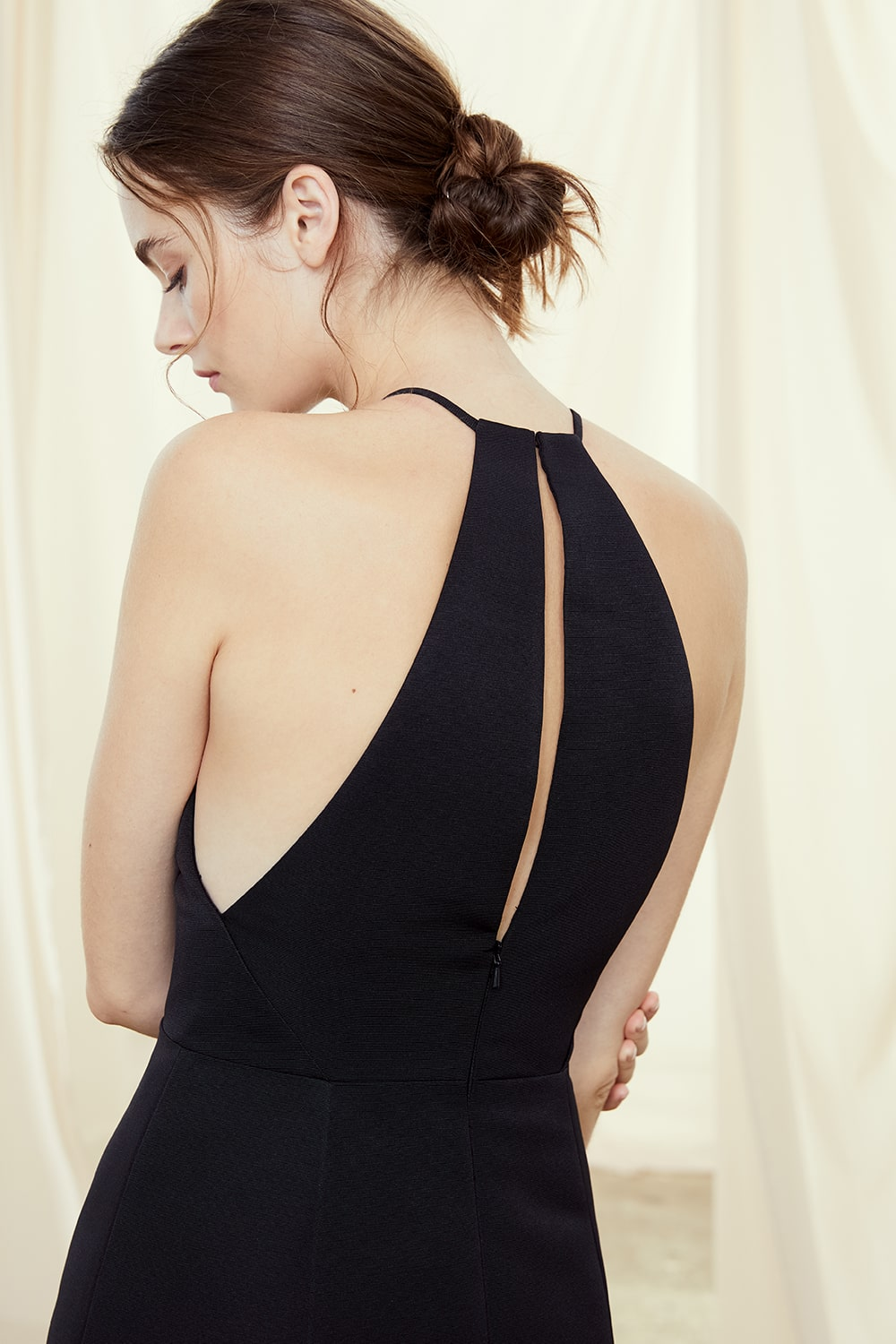 Close up of back of Amsale Bridesmaids style Caroline in black faille