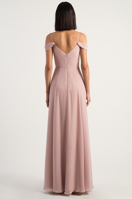 Back view of Priya in Whipped Apricot with cold shoulder detail by Jenny Yoo Bridesmaids