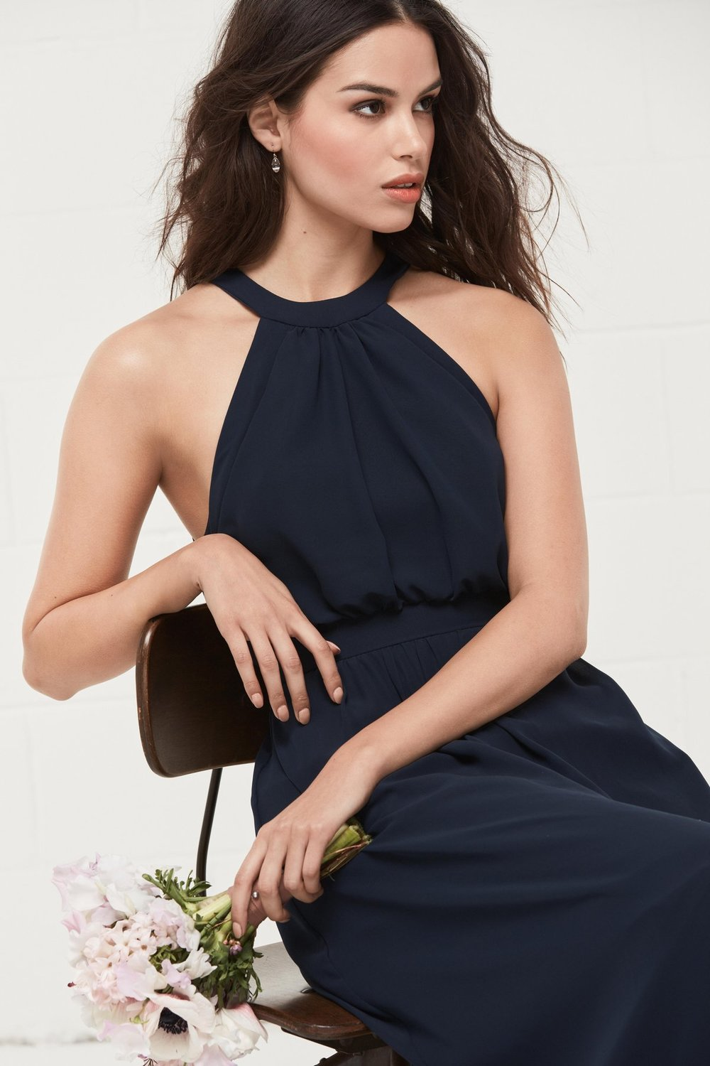 Bridesmaid sitting on a chair in 403 style by WToo by Watters Bridesmaids