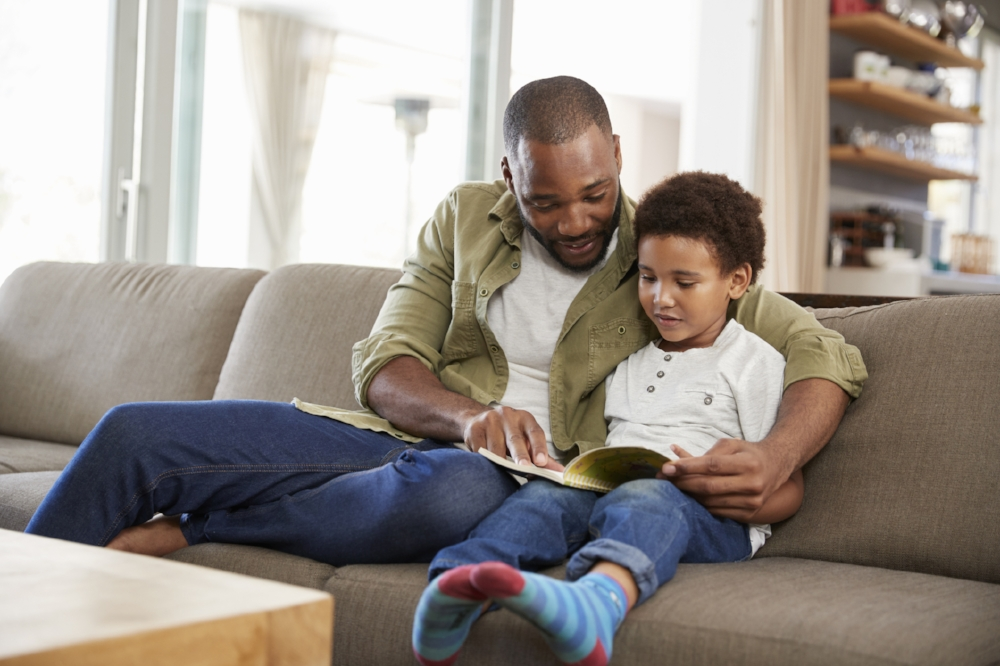Parents Reading to Child AdobeStock_5331722.jpeg