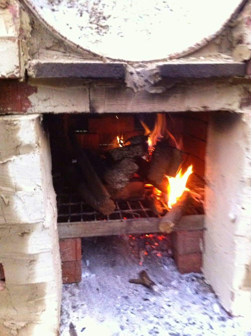 A blurry prototype Barrel oven is fired up for the first time.
