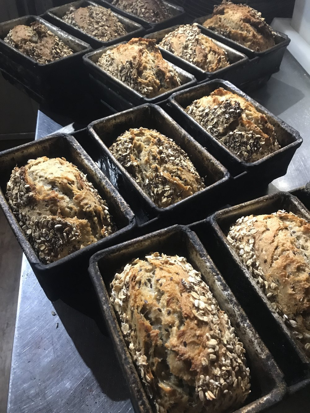 Some Seed + Grain breads transferring heat from the oven into the bench.