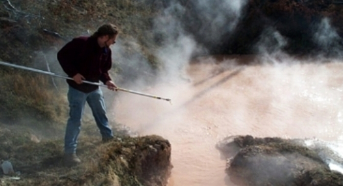 Dr. Stedman sampling  Sulfolobus  from Rabbit Creek Hot Spring in Yellowstone National Park, United States, 2001