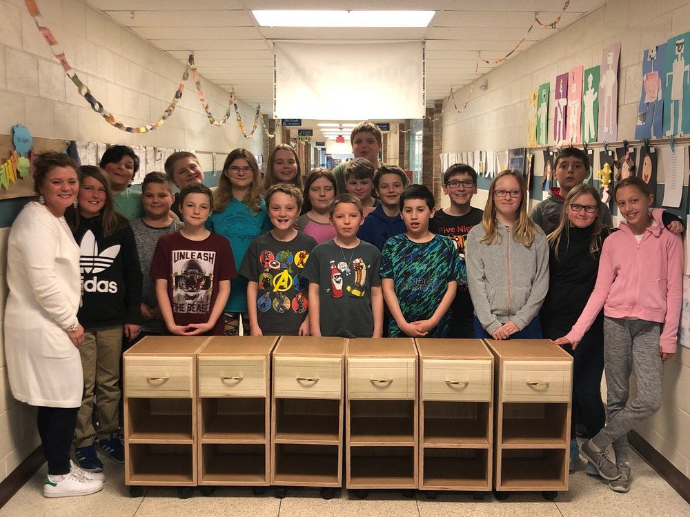 Ottawa Elementary - The kids in Jodi Adams' 5th grade class at Ottawa Elementary School in Petoskey needed to replace some portable storage cabinets. The Birchwood Construction Family had just the solution....a donation of 6 custom rolling storage carts hand built by one of our craftsman, Mark Adaline. From all the smiles, looks like Mark hit the mark!