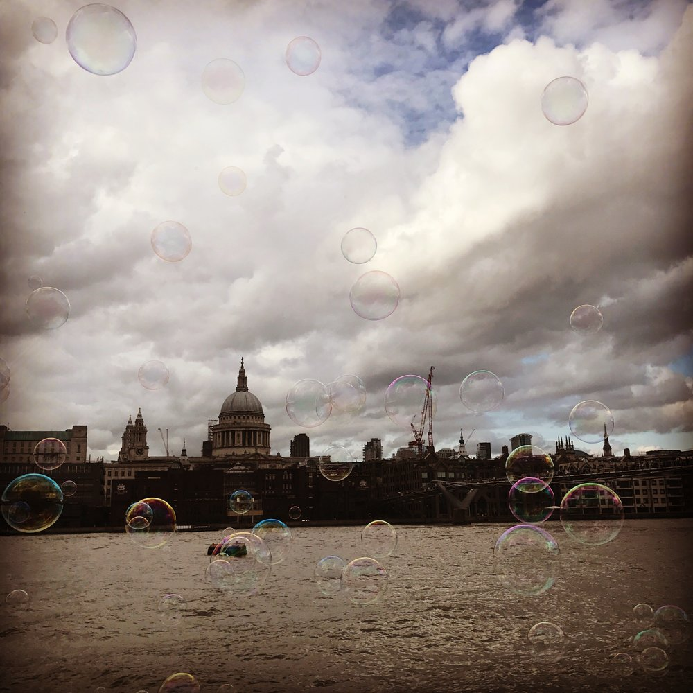 London's St. Paul's Cathedral with bubbles from South Bank.