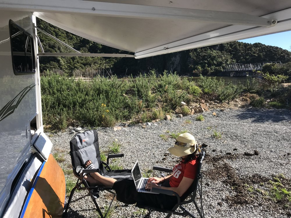 It isn't all glamour, but it sure beats an office! My current spot on Woodpecker Bay close to Paparoa National Park.