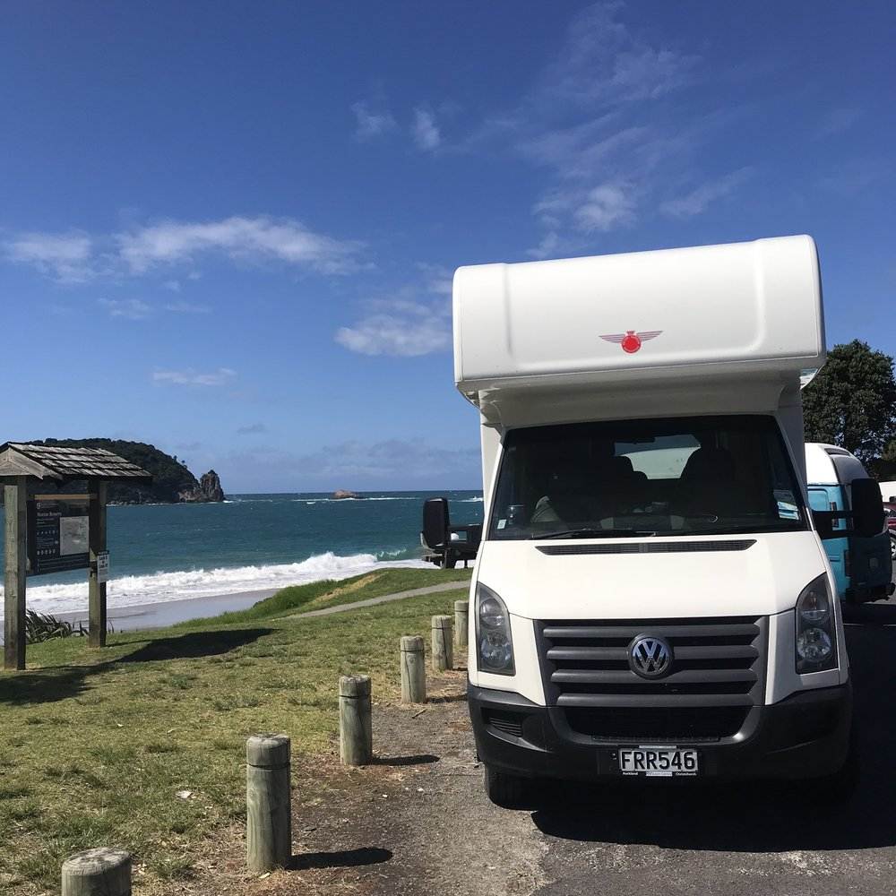 Home is where you park it - but first you need to simplify your stuff. Hahei beach, Coromandel Peninsula, New Zealand.