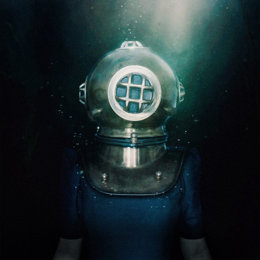Navigate the Dark  It worked! If you've been watching my stories today you'll have seen me talking my way through shooting this. I've always wanted to dabble in an underwater edit and so when this image popped into my head this morning I knew I had to shoot it. I shot with this helmet a while ago and wanted to continue the character, so here she is, navigating her way through the darkness.