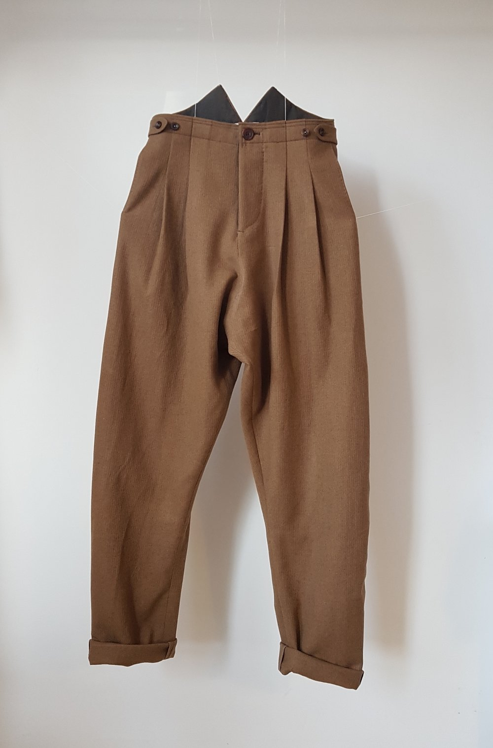 - Mid brown wool, light-grey Japanese cotton lawn lining.Amber horn buttons, with button fly & side straps