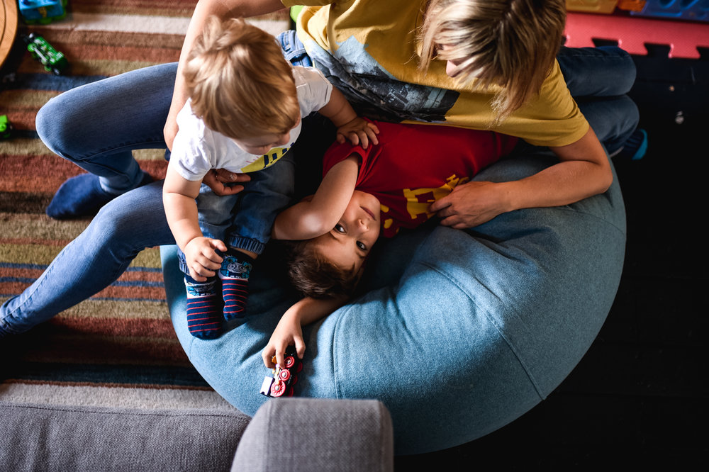 An aerial shot of a single mum and her two boys cuddling on a bean bag at their home in Bath, Somerset.