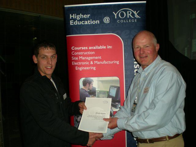 "Most Improved Banker Mason 2009 Joseph Hayton received this Province's Prize for the ""Most Improved Banker Mason"" at the  Awards Evening at York College. Joseph was presented with this award at the National Centre for Excellence in Stonemasonry at York College. The picture shows Joseph receiving his certificate from APGM David Marsh."