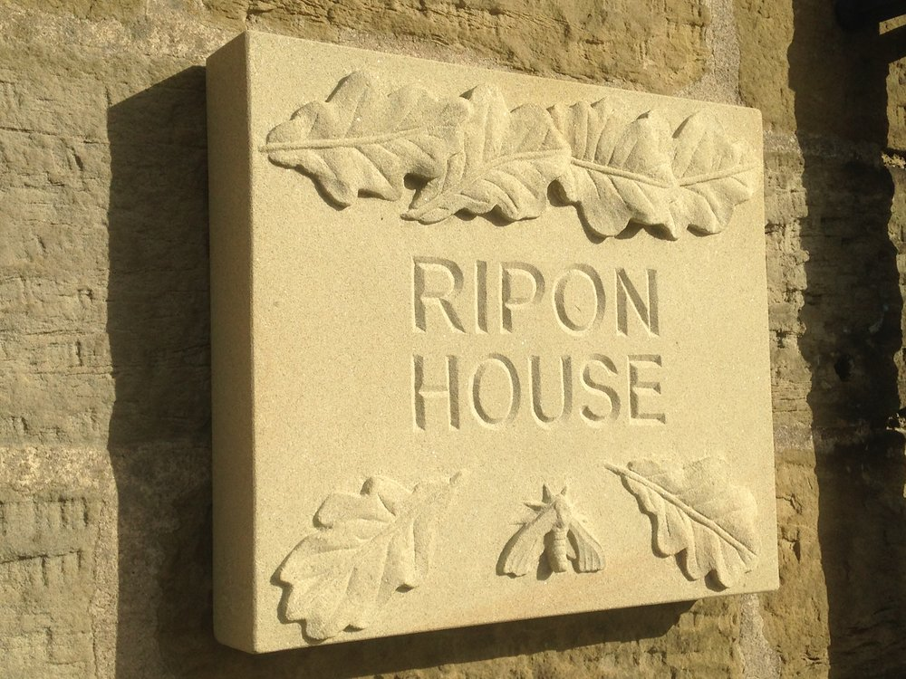 House sign with Oak leaves and Hawk moth