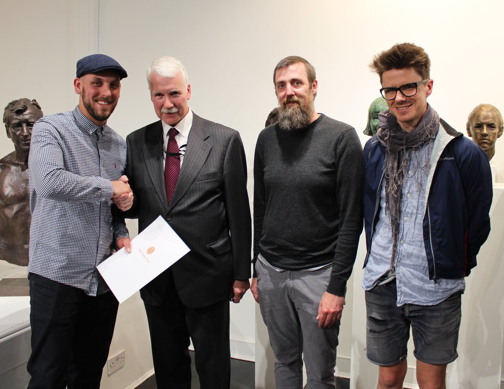 Tiranti Prize - FACE2018  - Joe's portrait of James Butler RA was awarded The Tiranti prize for best work by a sculptor aged 30 and under at the Society of Portrait Sculptors Face 2018 exhibition. Joe was presented the Tiranti award by Malcolm Hay, Curator of Works of Art, Palace of Westminster. The exhibition took place at La Galleria Pall Mall London and There were over 70 works on show including a piece by Rodin.