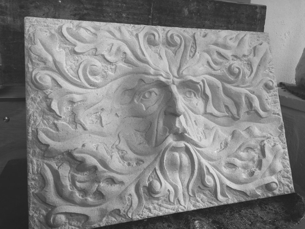 Green man in portland stone
