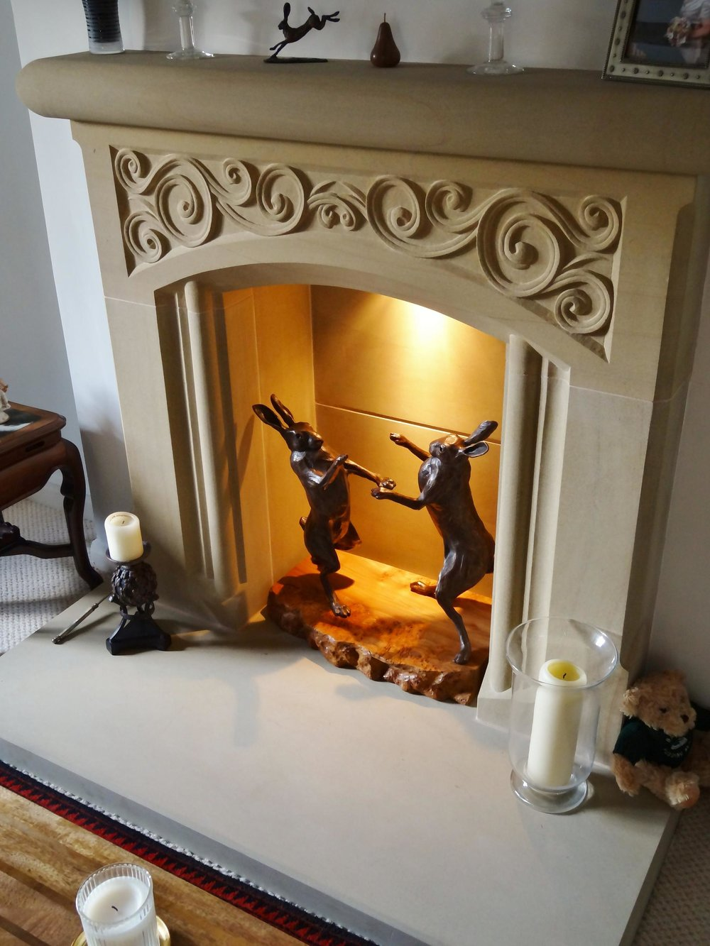 Bridge house fireplace with Bronze boxing hares