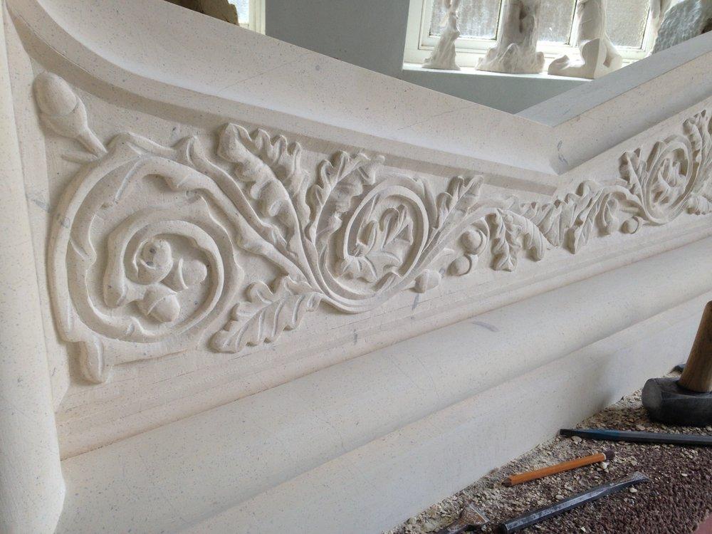 Oak leaf fireplace in Tadcaster limestone