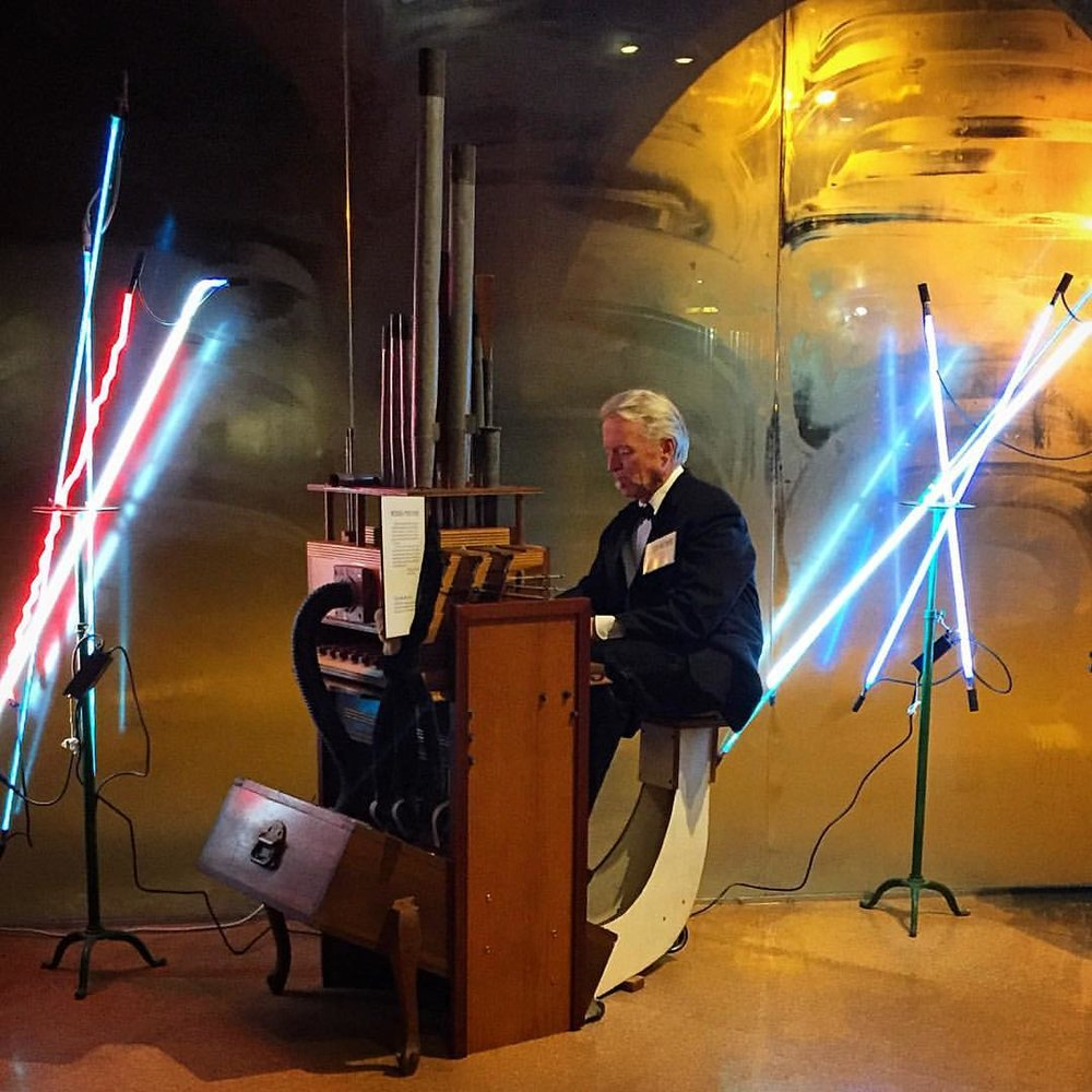 Jeffry Chiplis performs on his DIY portable pipe organ. Image by Jerry Mann, courtesy of SPACES.