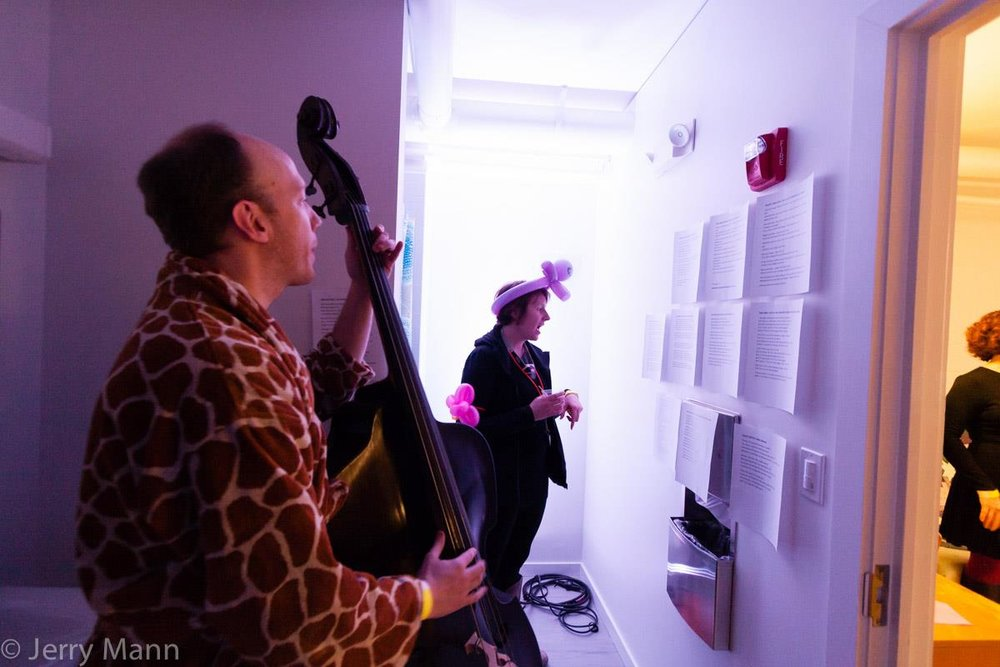 Adam Tully singing & playing bass in the shower. Image by Jerry Mann, courtesy of SPACES.
