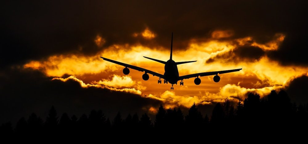 thumbnail of plane landing in sunset