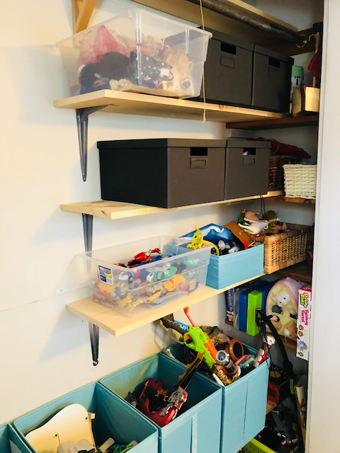 i ran 2 long shelves spanning the width of the closet on the very top, above the clothes bar for books and games and along the bottom to create space for large toy storage bins. three additional shelves span half the width of the closet, leaving room for hanging clothes