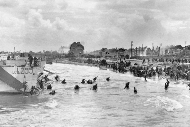 Canadian soldiers from 9th Brigade land with their bicycles at Juno Beach in Bernieres-sur-Mer on D-Day