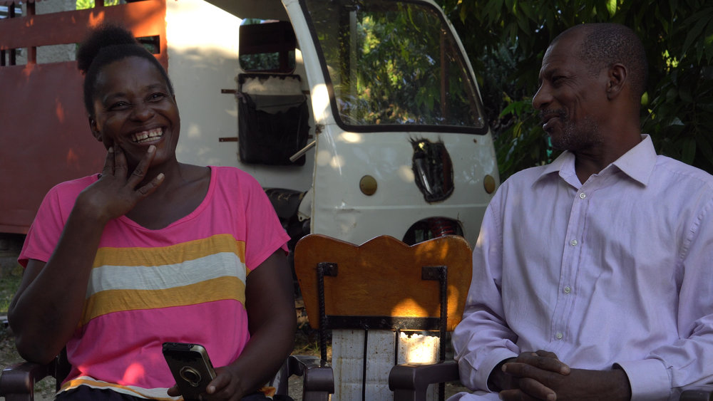 Wilda and Jacob sat down in front of a camera to give a brief interview. In the background is the vehicle that their son Eliezer refurbished after his father taught him metal work.