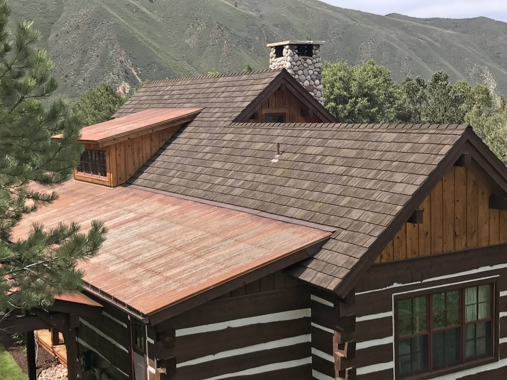 Metal Accents and Full Metal Roofing Systems - If you're looking for a metal roof, we can help. With anything from a small decorative metal section in copper or other coloring, to a full metal system The Roofing Center can help you get the look and protection you want.