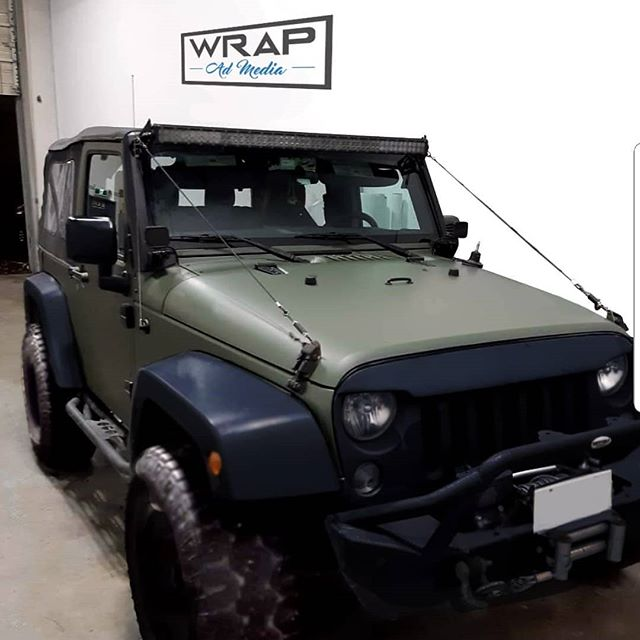 Badass Jeep Wrangler! Transformation from white to matte green. We took it apart to get the best, most seamless color change possible. Tell me it doesn't look like paint!  These projects are very satisfying, especially seeing the owners face on pick up. #jeep #jeepwrangler #jeeplife #vinyl #vinylwrap #transformationtuesday #laidnotsprayed #wrapadmedia