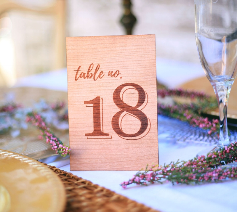 Custom designed wood engraved table numbers, a beautiful