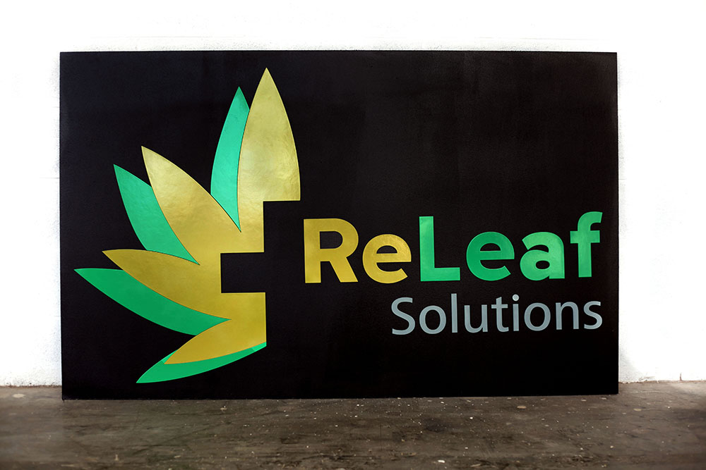 A large indoor wall sign made laser cut for a marijuana brick and mortar store.